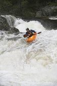image of canoe boat man  - View of a man kayaking in rough river - JPG