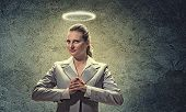 foto of halo  - Image of businesswoman with halo above head - JPG