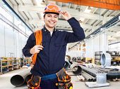 stock photo of electrician  - Portrait of an happy worker in a factory - JPG