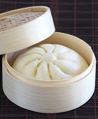 Chinese cuisine, steamed buns with stuffing in the bamboo steamer.