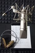 image of singer  - Condenser microphone prepared for singer in vocal recording room - JPG