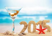pic of cocktail  - Cocktail on sandy beach and New year 2015 sign - JPG