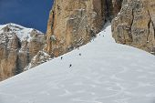 foto of suny  - jumping skier at mountain winter snow fresh suny day - JPG