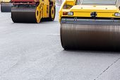 pic of vibrator  - Heavy vibration road rollers at asphalt pavement works - JPG