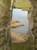 stock photo of stockade  - Seascape view from a blockhouse window photographed at Polruan in Cornwall - JPG