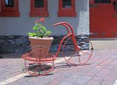foto of tricycle  - Cute Red tricycle with flower pot in Japan - JPG