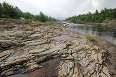 Постер, плакат: Exposed Rock River Landscape