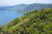 stock photo of wonderful  - Wonderful volcanic crater lake Apoyo located between the regions of Masaya and Granada in the Pacific basin - JPG