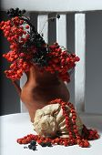 pic of mountain-ash  - composition from mountain ash clusters in a clay brown vase - JPG