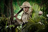 pic of machete  - Young explorer with machete finding a vintage telephone in the jungle - JPG