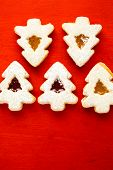 picture of linzer  - Linzer cookies in shape of Christmas tree on red background - JPG