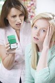 stock photo of teen smoking  - Mother Confronting Daughter Over Dangers Of Smoking - JPG