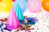 picture of birthday hat  - Birthday party decorations of hats noisemakers confetti and balloons - JPG
