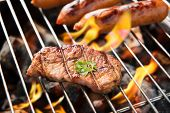 picture of grilled sausage  - BBQ sausages and meat on the grill - JPG