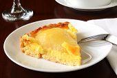 foto of custard  - A slice of gourmet pear tarte with almond custard filling - JPG