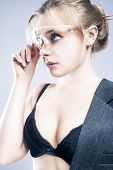 image of shot glasses  - Portrait of Young Caucasian Blond Female in Black Lingerie Touching Transparent Glasses - JPG