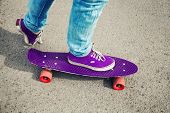 foto of snickers  - Skateboarder in jeans feet fragment with skate photo with retro tonal correction instagram old style - JPG