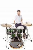 picture of drum-kit  - Handsome guy behind the drum kit on a white background in shirt and trousers - JPG