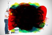 picture of paint pot  - Man using paint roller on white background against red green black yellow and blue paint - JPG