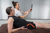 picture of supervision  - Doctor supervising the recovery of a sportsman patient - JPG