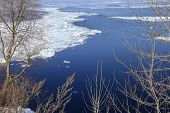 stock photo of crevasse  - landscape ice drift on the river in the spring on a sunny day - JPG