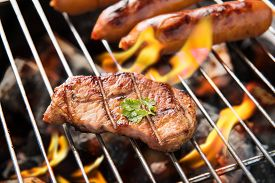 picture of braai  - BBQ sausages and meat on the grill - JPG