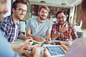 stock photo of employee  - Group of male employees talking to co - JPG