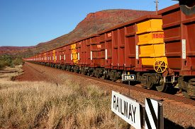 image of iron ore  - Hamersley Iron Ore Train with Hundreds of Carriages Hamersley Ranges Pilbara Western Australia - JPG