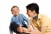 picture of tickle  - mom tickling son - JPG