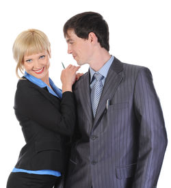 pic of office romance  - Beautiful blonde woman hugging a man in the suit - JPG