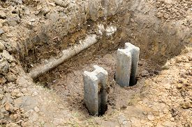 foto of foundation  - concrete foundation piles in construction site as for foundation of building - JPG
