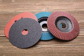 picture of abrasion  - Abrasive wheels isolated on wooden background in studio - JPG