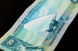 stock photo of dirham  - Banknote in twenty dirhams of the United Arab Emirates close up - JPG