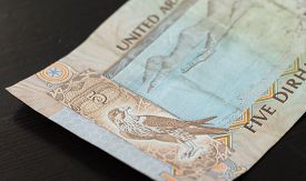 foto of dirham  - Banknote of the United Arab Emirates in five dirhams close up - JPG