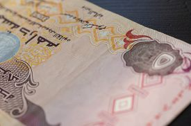 image of dirham  - Banknote of the United Arab Emirates in five dirhams close up - JPG