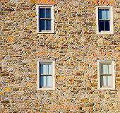 stock photo of fieldstone-wall  - Stone Wall with White Windows - JPG