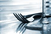 place setting - close-up of knife, fork, glass - toned