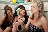 foto of pep talk  - Pouting woman on phone with friends in kitchen - JPG