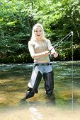 foto of fisherwomen  - woman fishing in river - JPG