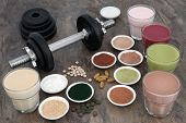 Weight training equipment for body builders with dumbbell weights, dietary food supplements and vita poster