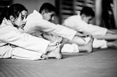 Martial Arts Training Class For Children On Training Indoors, Black And White Image poster