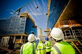 stock photo of highrises  - building under construction with workers - JPG