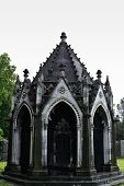 picture of burial-vault  - A decayed mausoleum on a rainy day showing signs of decay - JPG