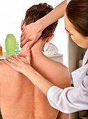Shoulder and neck massage for woman in spa salon. Doctor making neck therapy in rehabilitation cente poster