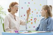 Little Girl During Speech Therapy poster