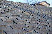 Bitumen Tile Roof. Roof Shingles - Roofing. Close Up View On Asphalt Roofing Shingles . poster