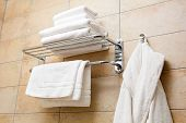 stock photo of housecoat  - This is a closeup of a towels and bathrobes - JPG