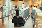 A Worker Is Transporting Trolleys For Luggage At The Airport. Trolleys Luggage In Airport. Close-up  poster