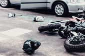 Helmet And Motorcycle Next To Broken Peaces Of A Car On The Street After Car Crash poster