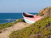 Beach Landscape - Skiff Boat On The Cliff